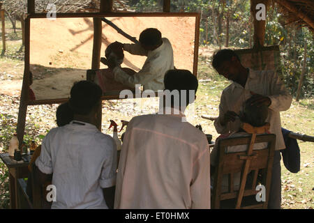 Villages barber shop in Jharkhand ; India - Stock Photo