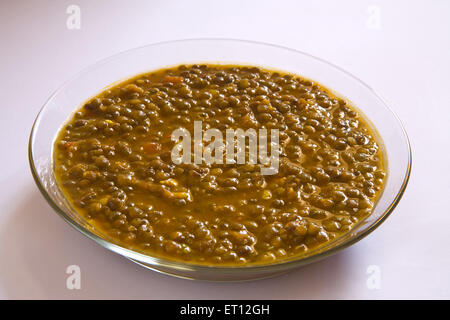 Indian masoor dal red gram lentil soup in glass bowl on white background 21 April 2010 - Stock Photo