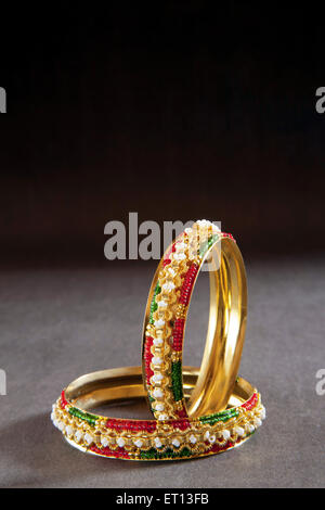 Gold Bangles - Stock Photo