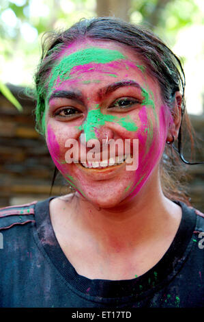 Indian girl face smeared with colors Holi Festival India -  MR#364 - RMM 178235 - Stock Photo