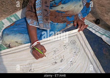 Artist Drawing Figures on Paper with black Pen Madhubani Bihar India Asia - Stock Photo