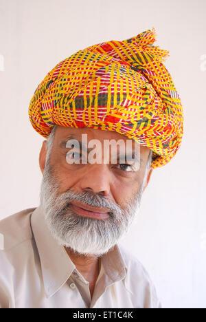 Portrait of educated rajasthani man in traditional turban ; Jodhpur ; Rajasthan ; India MR#704 - Stock Photo