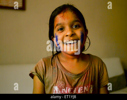 Young Indian girl with Holi festival colors on cheeks India MR#477 - Stock Photo