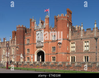 Hampton Court Palace west front entranceflying Union Jack Flag . A royal palace in the London Borough of Richmond - Stock Photo