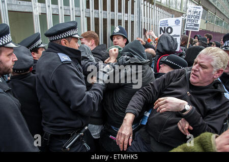 Activists clash with police and security guards at a protest against the demolition of the Aylesbury Estate in Southwark, - Stock Photo
