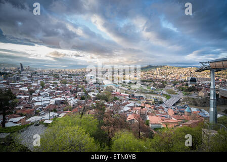 Tbilisi view with Bridge of Peace and Concert Hall seen from Narikala Fortress hill in Tbilisi, Georgia - Stock Photo