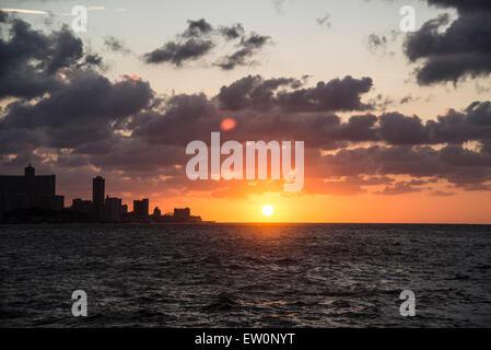 Sunset on the Malecon in Havana - Stock Photo