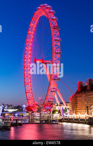 The London Eye is a giant Ferris wheel on the South Bank of the River Thames in London. Also known as the Millennium - Stock Photo