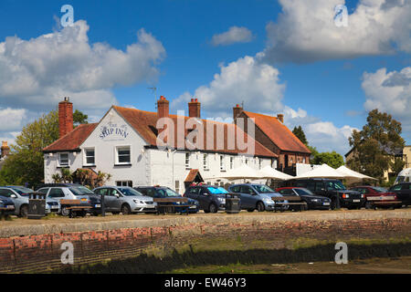 Cars parked around the harbour wall in front of the Ship Inn at Langstone on a summers day - Stock Photo
