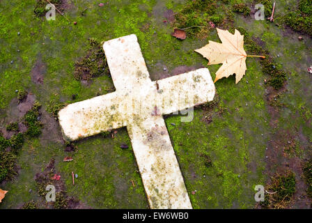 Cross with Leave as Symbol of sadness on the old graveyard of bonn germany europe - Stock Photo