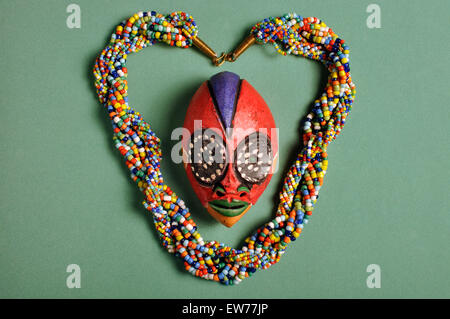 Beaded Kenyan necklace with small Cameroon'passport' mask - Stock Photo