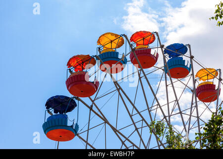 Ferris wheel against blue sky background in city park - Stock Photo