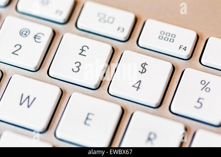 Euro Pound Dollar and Percent signs on a computer keyboard - Stock Photo