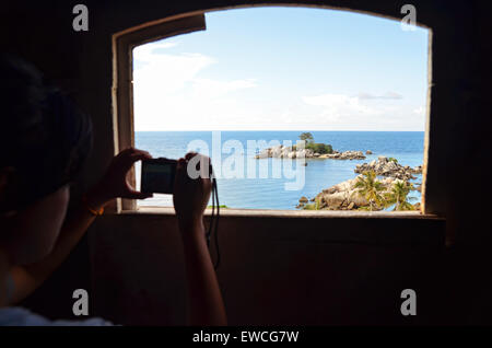 View of an islet seen from lighthouse window in Lengkuas island - Stock Photo