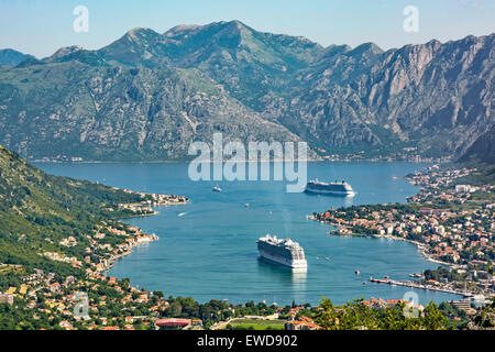 Montenegro,Kotor looking down onto the town and Bay of Kotor with cruise ships Regal Princess and Celebrity Silhouette - Stock Photo