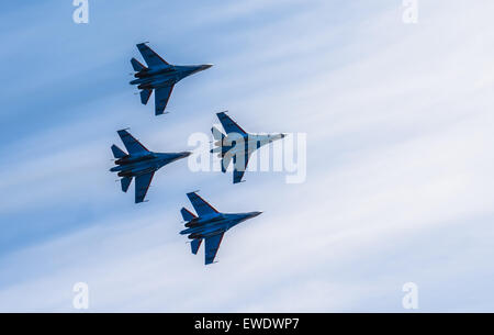 Silhouettes of russian fighter aircrafts in the sky - Stock Photo