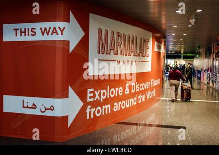 Qatar Doha Hamad International Airport DOH terminal concourse gate area inside interior shopping Arabic English - Stock Photo