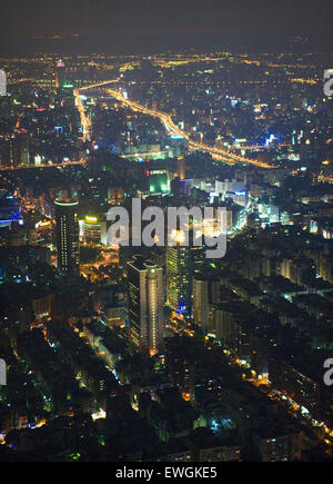 Ariel view of Taipei at dusk from the 88th floor of Taipei 101. - Stock Photo