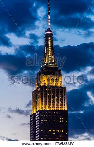 Empire State Building illuminated at twilight, New York, New York USA. - Stock Photo