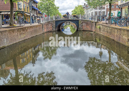Canal view with reflections in the water of the townhouses and trees along Oude Delft, Delft, South Holland, The - Stock Photo
