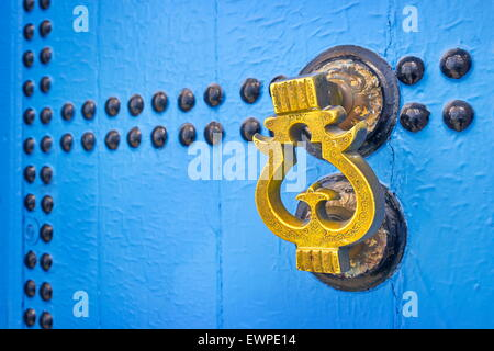 Door knocker, Chefchaouen (Chaouen) known as Blue City, Morocco. - Stock Photo