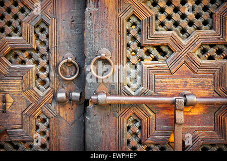 Fez. Historic wooden door in old house, Medina. Detail of the decorative ornament. Morocco, Africa - Stock Photo