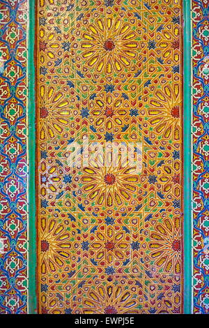 Ornate, carved and painting door  to a mosque. Morocco - Stock Photo