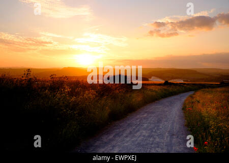 Brighton, 19 June 2015: The sun sets over the South Downs National Park with The American Express Community Stadium - Stock Photo