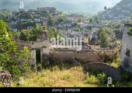 Empty houses at ghost town village Kayakoy ruins near Fethiye in Turkey, 2015 - Stock Photo