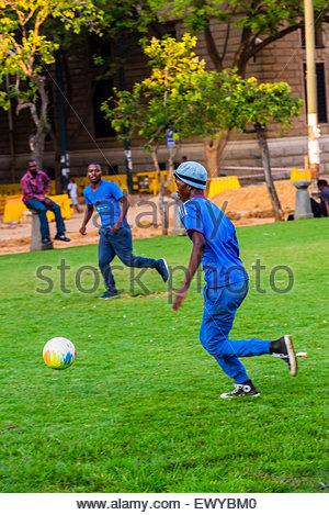 Playing soccer, Church Square (Kerkplein), Pretoria, South Africa. - Stock Photo