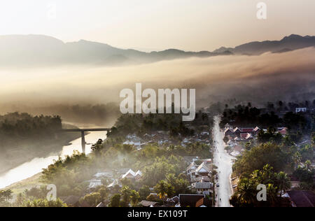 """Luang Prabang at sunrise from the top of Mt. Phou Si. In the Lao language, """"Phou"""" means mountain and """"Si"""" means - Stock Photo"""