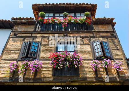 Colourful flowers on balconies, Santillana del Mar, Spain - Stock Photo