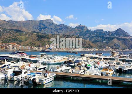 View from Giardini Naxos beach towards Taormina and Castlemola villages on Cape Taormina, Sicily, Italy - Stock Photo