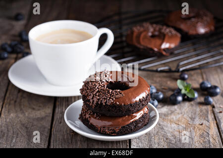 Chocolate gluten free donuts with coffee and blueberries - Stock Photo