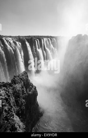 Africa, Zimbabwe, Victoria Falls National Park, Zambezi River as it flows over Victoria Falls - Stock Photo