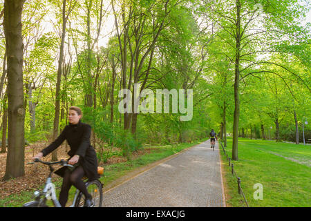 Berlin park, cyclists using the extensive cycle paths in the Tiergarten park, spring, Berlin, Germany - Stock Photo