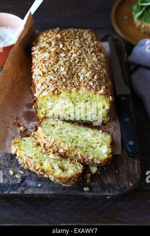 zucchini bread with cheese on cutting boards - Stock Photo