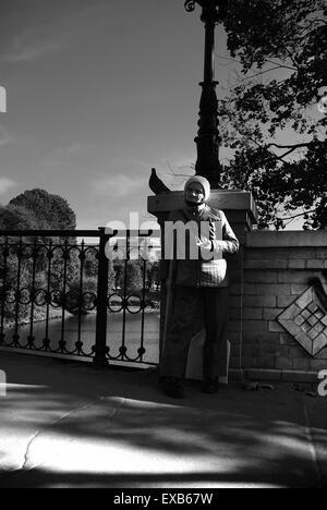 Beggar on a bridge over the Pilsetas Canal, Riga, Latvia - Stock Photo