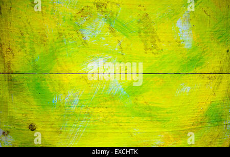 Old wooden surface painted in yellow green colors, details of a texture. - Stock Photo