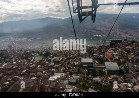 A view of the lower income neighborhoods  on the slopes above Medellin, Colombia from the Teleférico or air tram - Stock Photo