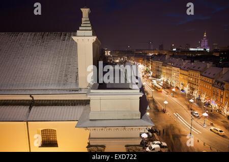 Poland, capital city of Warsaw, St. Anne Church and Krakowskie Przedmiescie street by night from above - Stock Photo