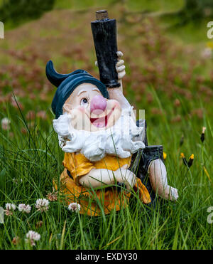 Funny Dwarf in the garden - Stock Photo