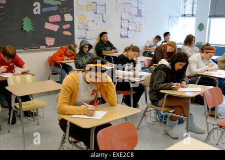 High school secondary students in classroom taking test - Stock Photo