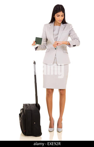 professional Indian business traveler checking time - Stock Photo