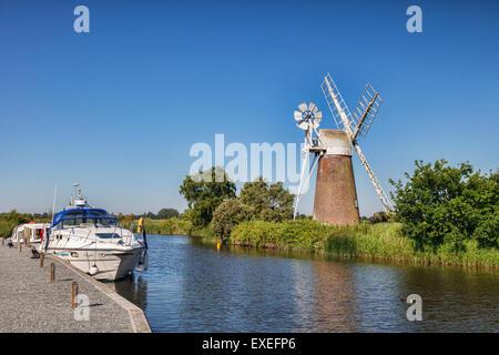 Motor cruisers moored near Turf Fen Windmill on the Norfolk Broads, Norfolk, England - Stock Photo