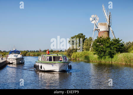 Motor cruisers near Turf Fen Windmill on the Norfolk Broads, Norfolk, England - Stock Photo