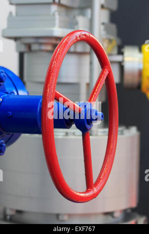Red handwheel of the industrial steel gate valve. - Stock Photo
