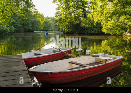 Rowing boats for rent  in summer at Cafe am Neuen See in Tiergarten park in Berlin Germany - Stock Photo