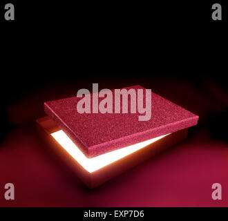 Red color gift box.Opened box against black background with copy space. Light effect inside. Clipping path on the - Stock Photo