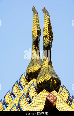 Ornate roof ridges in Wat Po, Bangkok, Thailand - Stock Photo